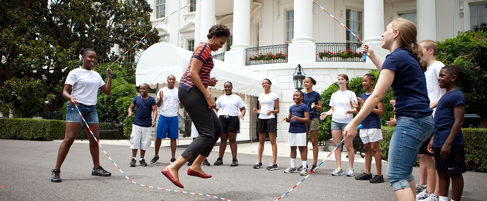 First Lady Michelle Obama and kids double-dutch jump rope during a taping for the Presidential Active Lifestyle Award (PALA) challenge and Nickelodeon's Worldwide Day of Play, on the South Lawn of the White House, July 15, 2011.