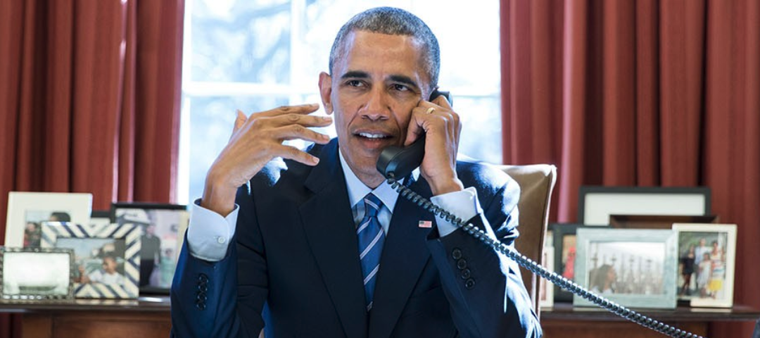 Obama speaks on the phone in the Oval Office