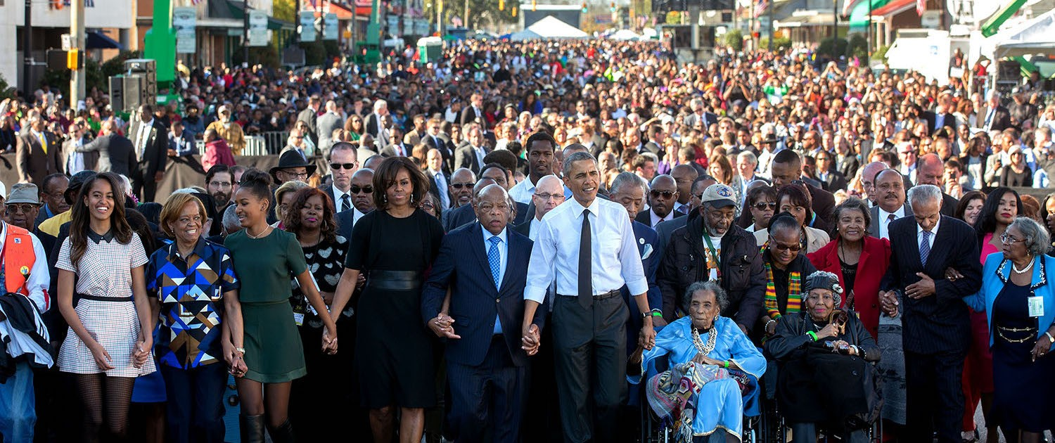The First Family with Representative John Lewis and others walking across Edmund Pettus Bridge, March 7, 2015.